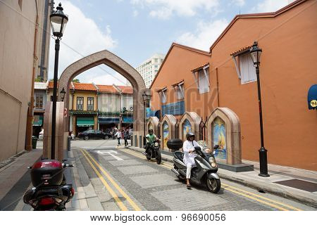 SINGAPORE - CIRCA FEBRUARY, 2015: People in the Arab quarter (Kampong Glam). The Arab Quarter is the oldest historic shopping district of Singapore, is very popular for visits by foreign tourists.