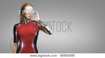 people, technology, future and progress - young woman with futuristic glasses and microchip implant or sensors over gray background