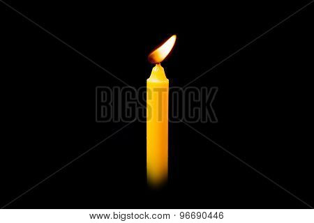 Yellow Fire Burning Candle On Black Background.