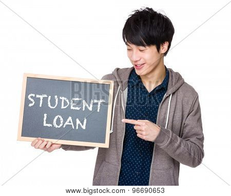 Young man finger point to chalkboard showing a phrases of student loan