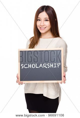 Woman hold with chalkboard showing a word scholarship