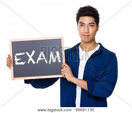 Asian mixed Indian man with blackboard showing a word exam