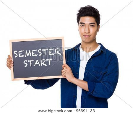 Asian mixed Indian man with blackboard showing phrases of semester start