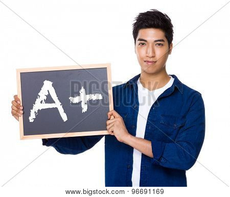Asian mixed Indian man with blackboard showing sign of A plus