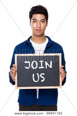 Indian man with chalkboard showing a phrase of join us