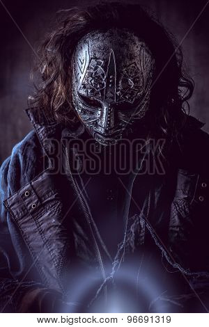 Portrait of a mysterious man in iron mask. Steampunk. Fantasy. Halloween.
