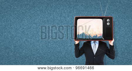 Businessman hiding head with a box against orange