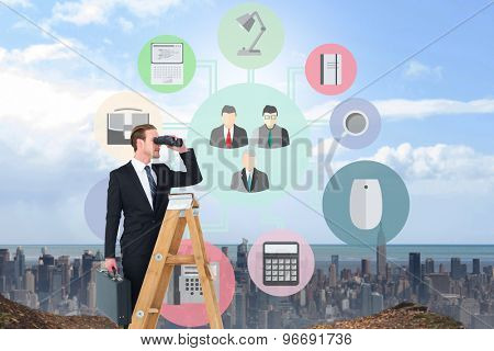 Businessman looking on a ladder against large city on the horizon