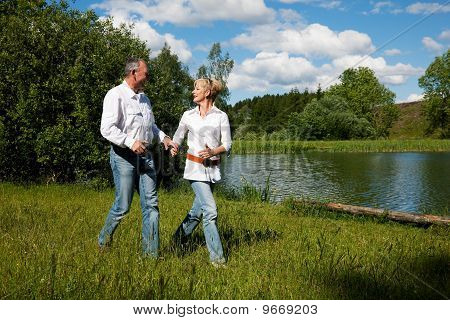 Senior Couple at a lake in summer