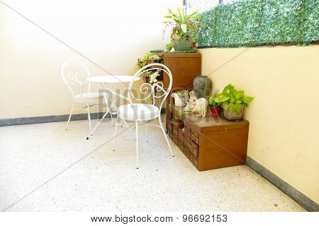 White Chair And Desk And Plant Decorating On Wooden Desk Drawer