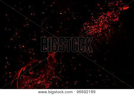 red  hot sparks on a black background