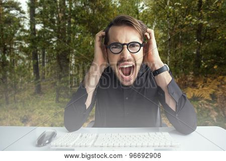 Businessman yelling with his hands on face against scenic view of walkway along lush forest