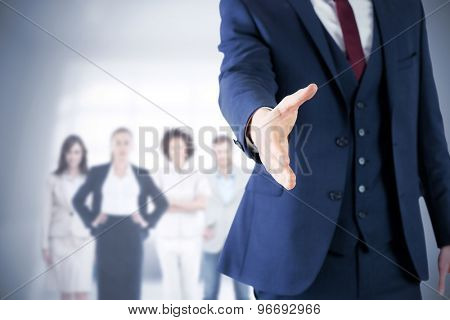 Composite image of businessman ready to shake hand