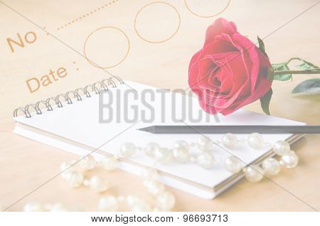 Red Rose And Open White Diary.
