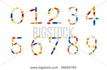 Numbers made with pills isolated on white