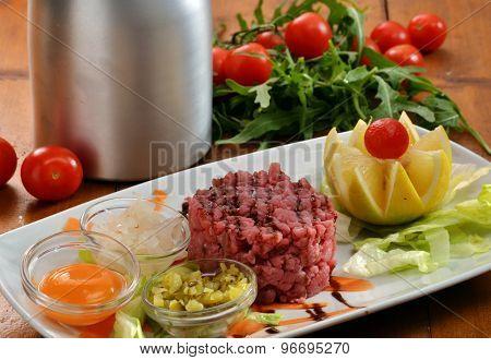 Tuna tartar dish and sauces.