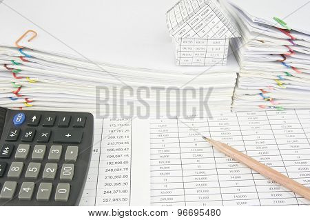 Brown Pencil And Calculator On Finance Account