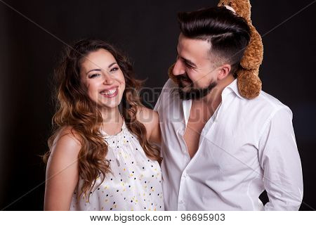 Laughing Couple Over Black Background