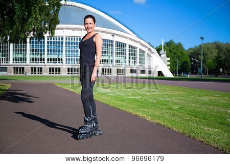 Roller Skating Girl In Park Rollerblading On Inline Skates