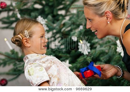Christmas - child receiving a gift