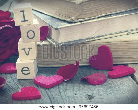 Love Stories, old books in retro arrangement