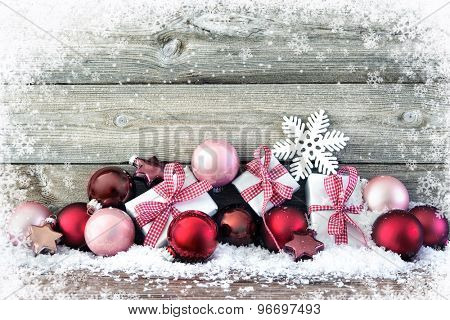 Christmas composition with colorful balls and gift boxes on snow