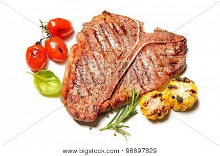 Grilled beef steak with vegetables isolated on white