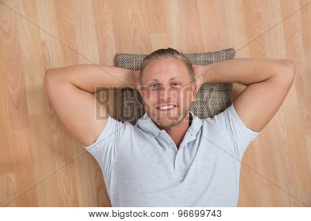 Man Lying On Floor