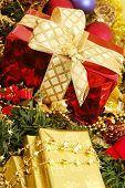 picture of mica  - gold christmas ornaments with christmas lights on christmas time   - JPG