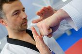 stock photo of karate  - Kid in a karate lesson - JPG