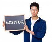 foto of mentoring  - Asian mixed Indian man with blackboard showing a word mentor - JPG