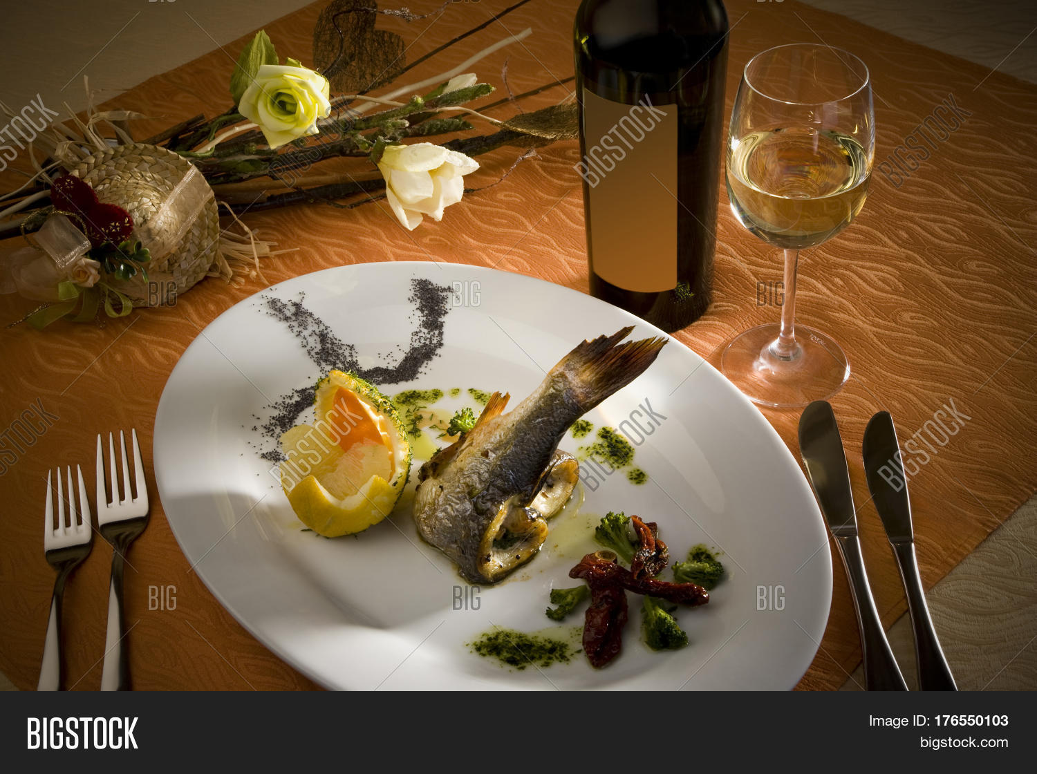 Exquisite dinner dish with fish and white wine stock photo for White wine with fish