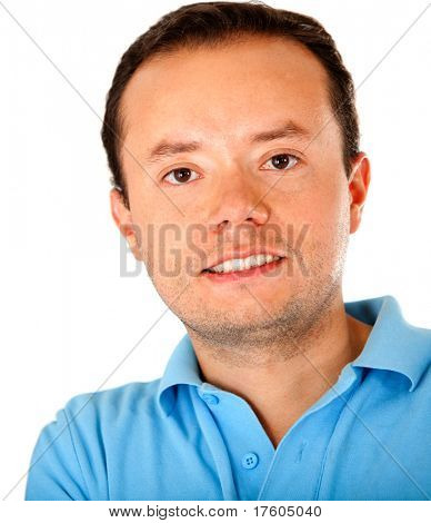 Casual man smiling and leaning against a white wall