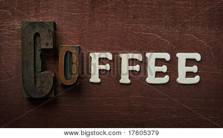 The word coffee written on wooden background