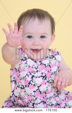 Girl Smiling And Waving Hello