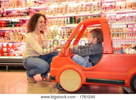 Child Mother  In Supermarket