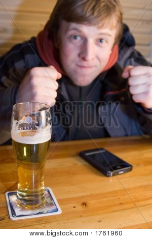 Fan With Beer And Palm-Size Computer