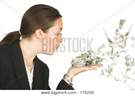 Business Woman Blowing Dollars