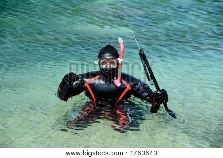 Underwater Hunter For Beer Dressed In Neoprene Dry Suit With Riffle