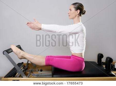 pilates reformer woman gym fitness teacher legs exercise