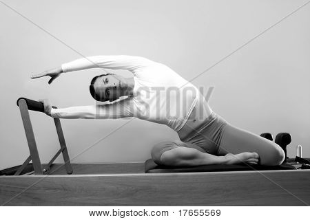 black and white pilates woman sport fitness portrait on reformer