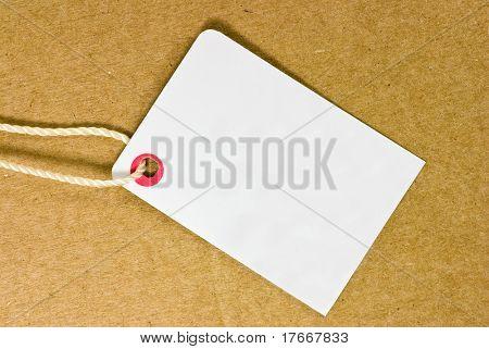 blank tag on cardboard background