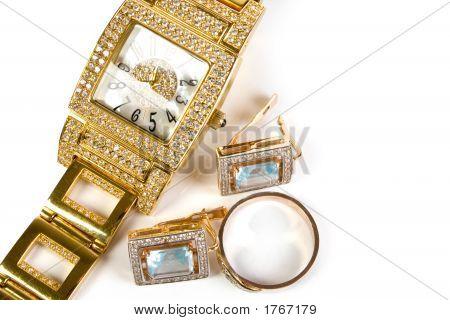 Golden Clock And Jewellery