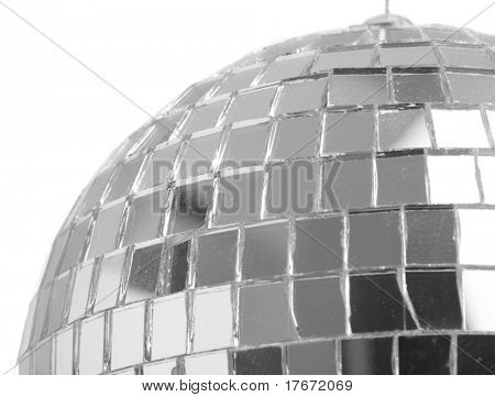 extreme closeup of a mirrorball on white background