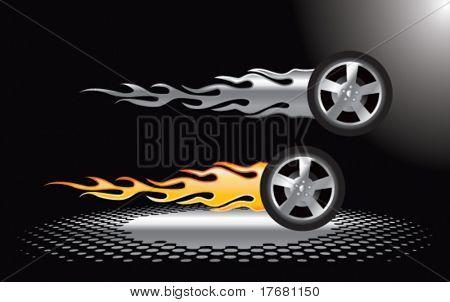 flaming tires under spotlight