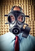 pic of s10  - portrait of businessman wearing classic gas mask - JPG