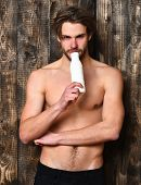 Caucasian Bearded Sexy Macho Man Holding Kefir Or Yogurt poster