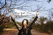 Young Woman Hands Holding Sign Said Free Your Mind poster