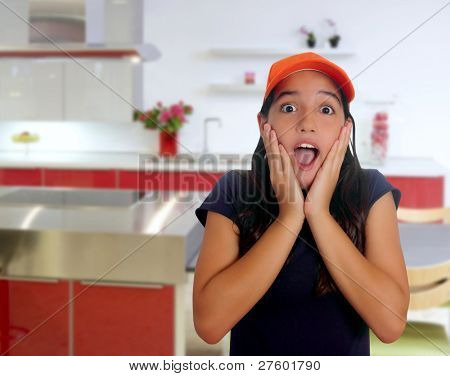 Beautiful Latin teen hispanic girl with cap and surprise gesture in a house kitchen [ photo-illustration]