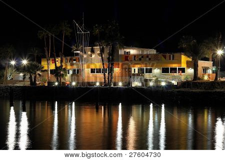 Renovated North Shore Beach & Yacht Club at the Salton Sea at nighttime. Reflections on the water.
